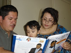 Parents reading book to son.